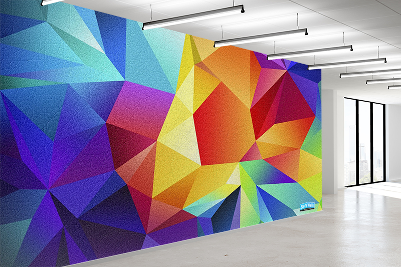 A geometric wall covering is prominently featured in a hospital hallway.